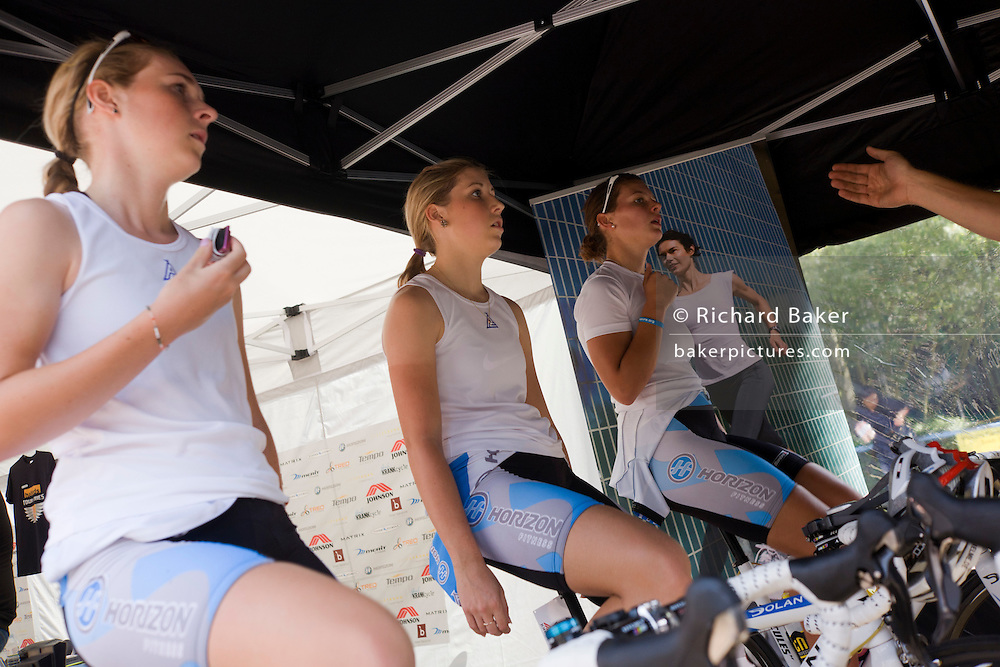 Members of the Horizon Fitness womens' road racing cycling team warm-up on their Turbo rollers before competition.