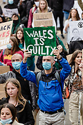 """Protester holds a sign up with """"Wales is guilty'' on it during the Black Lives Matter protest in Cardiff, Wales on 6 June 2020."""