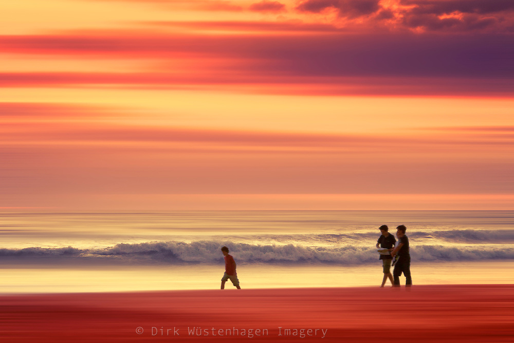 Abstraction of a beach with people enjoying a walk at sunset.<br />