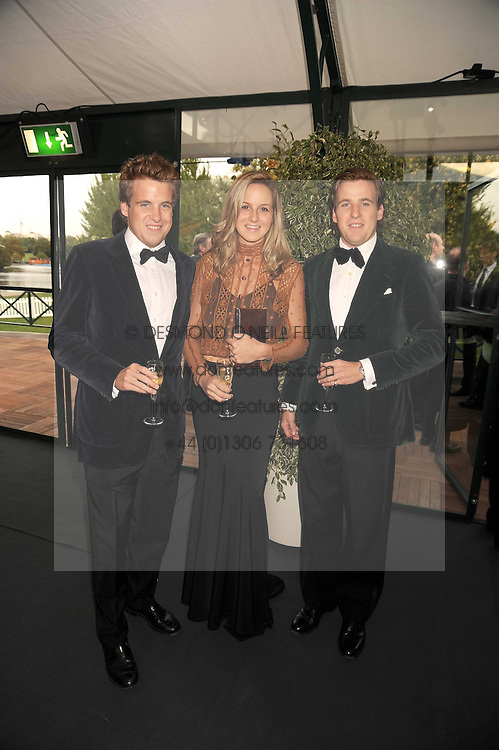 Left to right, EDWARD LAWSON-JOHNSTON and HARRY & CHARLOTTE LAWSON-JOHNSTON at the Royal Parks Foundation Summer Party hosted by Candy & Candy on the banks of the Serpentine, Hyde Park, London on 10th September 2008.