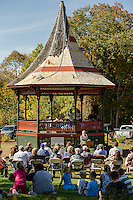 Belmont Heritage Commission Chairman Linda Frawley addresses the crowd gathered for the Historic Bandstand's Community Salute on Sunday afternoon.  (Karen Bobotas/for the Laconia Daily Sun)