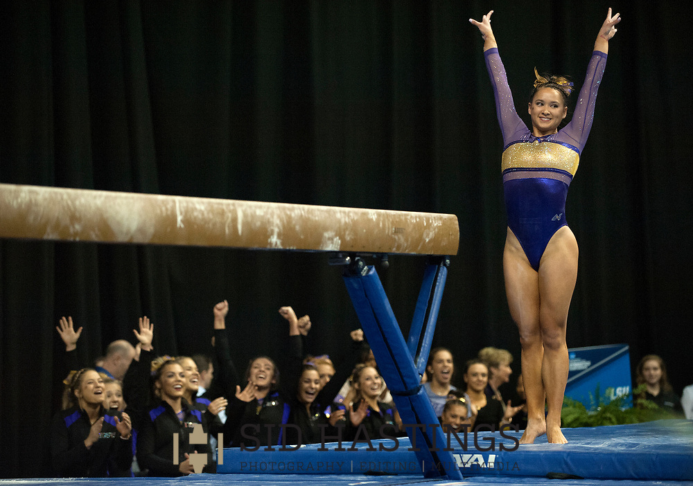 20 APRIL 2018 -- ST. LOUIS -- LSU gymnast Sarah Finnegan is cheered by her teammates after competing in the Balance Beam during the 2018 NCAA Women's Gymnastics Championship Semifinals in St. Louis Friday, April 20, 2018. LSU finished second in the semifinal, joining UCLA and Nebraska in advancing from the first semifinal into the Super Six championship round on Saturday.<br /> <br /> Photo &copy; copyright 2018 Sid Hastings.
