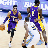 02 March 2016: Los Angeles Lakers guard D'Angelo Russell (1) drives past Denver Nuggets forward Will Barton (5) on a screen set by Los Angeles Lakers forward Brandon Bass (2) during the Denver Nuggets 117-107 victory over the Los Angeles Lakers, at the Pepsi Center, Denver, Colorado, USA.