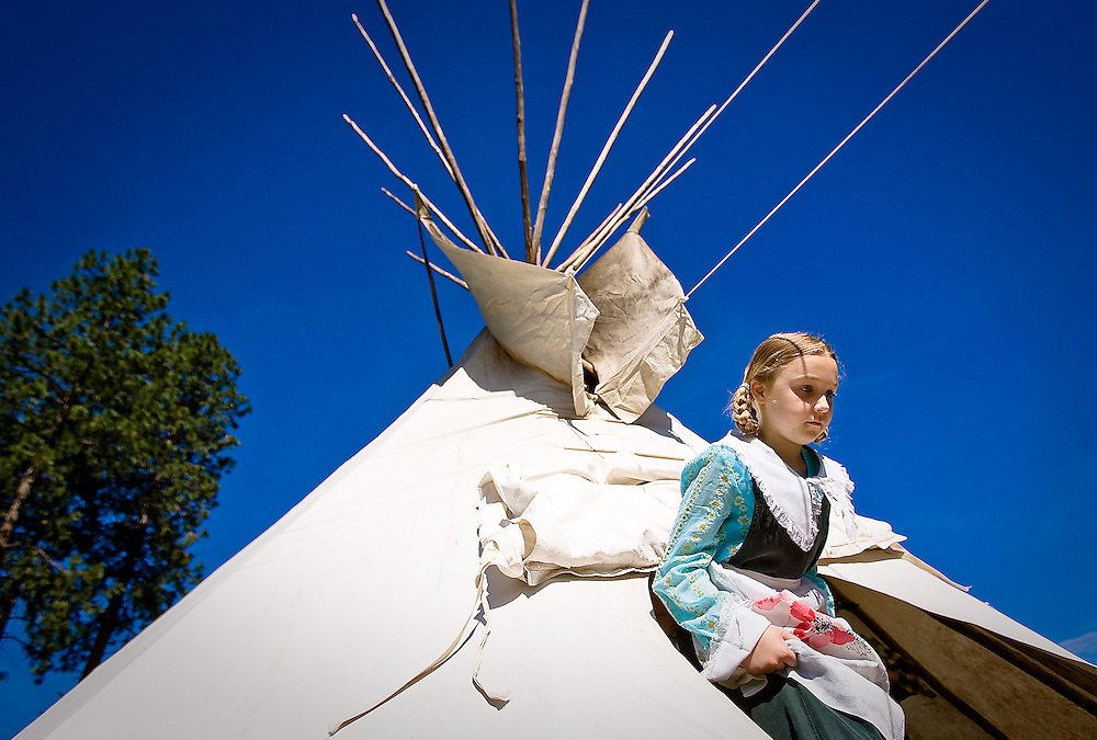 JEROME A. POLLOS/Press..Zoë Peterson, 9, exits a tepee that was built at Ponderosa Elementary's Rendezvous Days held Wednesday. Students toured and participated in various stations featuring archery, cast iron cooking, forestry, cavalry and artillery, Native American living and were given a ride on a horse and buggy.