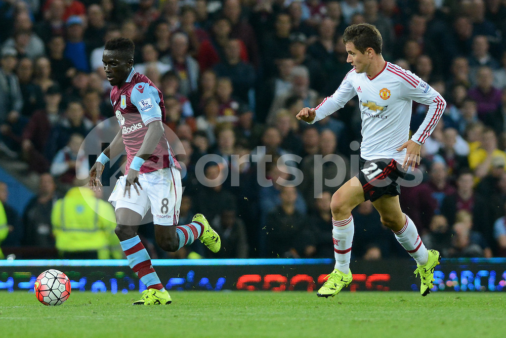 Aston Villa's Idrissa Gueye surges forward tracked by Manchester United's Ander Herrera during the Barclays Premier League match between Aston Villa and Manchester United at Villa Park, Birmingham, England on 14 August 2015. Photo by Garry Griffiths.