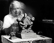 portrait of sculptor Tom Otterness while working 2002