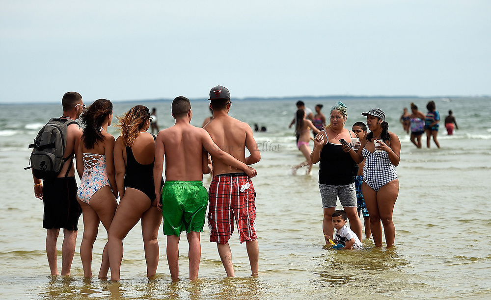 7/3/16 :: REGION :: STAND ALONE :: A group of beachgoers pose for a photo in the sand bar shallows at Rocky Neck State Park Sunday, July 3, 2016. (Sean D. Elliot/The Day)