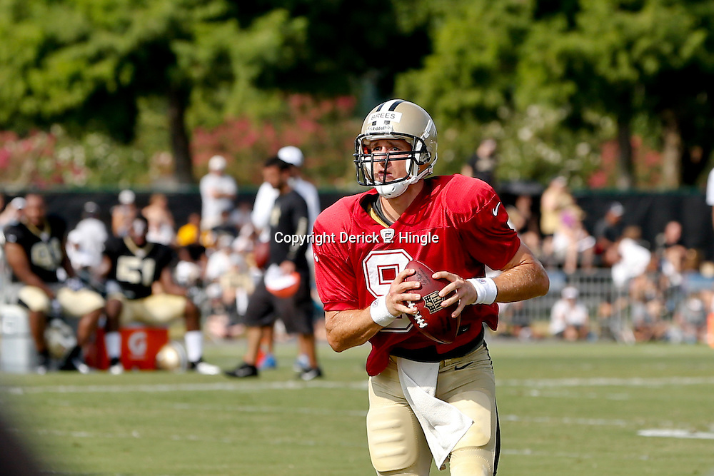 Aug 3, 2013; Metairie, LA, USA; New Orleans Saints quarterback Drew Brees (9) during a scrimmage at the team training facility. Mandatory Credit: Derick E. Hingle-USA TODAY Sports