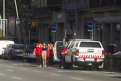 August 17, 2017 - Barcelona, Spain - A woman is helped by Spanish Red Cross after a van ploughed into the crowd, killing 13 persons and injuring over 80 on the Rambla in Barcelona on August 17, 2017. A driver deliberately rammed a van into a crowd on Barcelona's most popular street on August 17, 2017 killing at least 13 people before fleeing to a nearby bar, police said. Officers in Spain's second-largest city said the ramming on Las Ramblas was a 'terrorist attack' (Credit Image: © Hugo FernáNdez Alcaraz/NurPhoto via ZUMA Press)