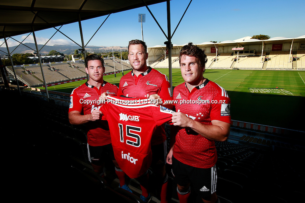 """Ryan Crotty of the Crusaders, Wyatt Crockett and Matt Todd pose with a Crusaders jersey with the new """"infor"""" sponsors logo on the back at a Crusaders back Sponsor announcement of infor and Crusaders captains run training session held at AMI Stadium, Christchurch. 12 February 2015 Photo: Joseph Johnson / www.photosport.co.nz"""