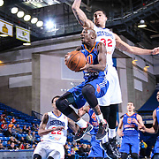 Westchester Knicks Guard Walker Russell (0) drives toward the basket as Delaware 87ers Forward Drew Gordon (32) defends in the second half of a NBA D-league regular season basketball game between the Delaware 87ers and the Westchester Knicks (New York Knicks) Wednesday, Feb. 17, 2015 at The Bob Carpenter Sports Convocation Center in Newark, DEL.<br />
