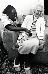 Care worker with elderly woman in residential care home, Nottingham, UK Jan 1989