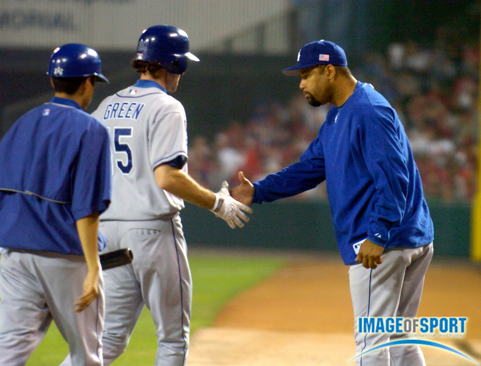 Jul 4, 2004; Anaheim, CA, USA; Shawn Green of the Los Angeles Dodgers is congratulated by Jose Lima after scoring in the seventh inning of 6-2 interleague victory over the Anaheim Angels at Angel Stadium.