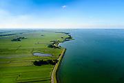 Nederland, Noord-Holland, Gemeente Edam-Volendam, 13-06-2017; Zeevangse Zeedijk.<br /> De dijk staat op de nominatie om verstrekt te worden, bewoners en actievoerders vrezen aantasting van de monumentale dijk en verlies culturele waarden.<br /> Edam with Fort at Edam and Zeevangse Zeedijk.<br /> The dike is nominated to be reinforced, residents and activists fear losing the monumental quality of the dike and losing other cultural values.<br /> <br /> luchtfoto (toeslag op standaard tarieven);<br /> aerial photo (additional fee required);<br /> copyright foto/photo Siebe Swart
