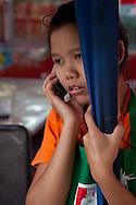 Thai girl calling to someone.