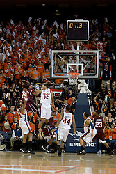 Virginia Tech forward Deron Washington (13) goes up for the game winning shot over Virginia forward Mike Scott (32).  The Virginia Cavaliers men's basketball team fell to the Virginia Tech Hokies 70-69 in overtime at the John Paul Jones Arena in Charlottesville, VA on January 16, 2008.