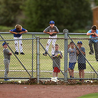 A group of young Tupelo High School Baseball fans watch from the outfield fence as the Golden Wave host the Oxford Chargers on Tuesday night.