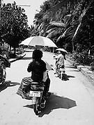 Motorcycles and umbrellas.