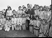 Charles Haughey Visits The Community Games. (T5)..1989..03.10.1989..10.03.1989..3rd September 1989..An Taoiseach, Charles Haughey TD,accompanied by Mr Frank Fahey, TD, Minister of State with responsibility for Youth and Sport attended the Twentieth National Finals of the Community Games at Mosney,  Co.Meath yesterday...An Taoiseach is pictured with a group of young contestants and their mentors at the community games in Mosney.