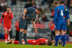 REYKJAVIK, ICELAND - Wednesday, May 28, 2008: Wales' Ched Evans lies injured during the international friendly match against Iceland as referee Adrian McCourt looks on at the Laugardalsvollur Stadium. (Photo by David Rawcliffe/Propaganda)