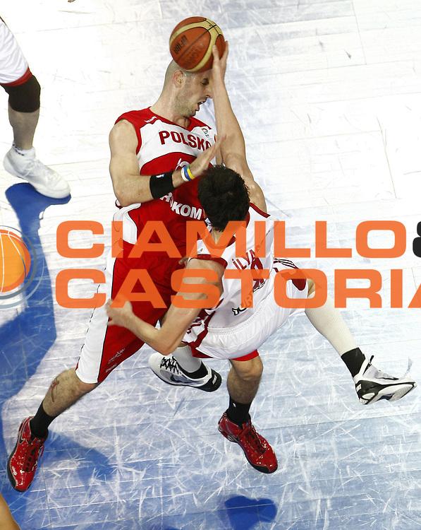 DESCRIZIONE : Wroclaw Poland Polonia Eurobasket Men 2009 Preliminary Round  Polonia Turchia Poland Turkey<br /> GIOCATORE : Ersan Ilyasova<br /> SQUADRA : Turchia Turkey<br /> EVENTO : Eurobasket Men 2009<br /> GARA : Polonia Turchia Poland Turkey<br /> DATA : 09/09/2009 <br /> CATEGORIA : tiro curiosita equilibrio<br /> SPORT : Pallacanestro <br /> AUTORE : Agenzia Ciamillo-Castoria/E.Castoria