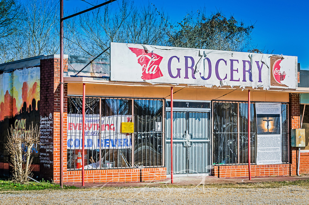 An abandoned storefront sits beside Civil Rights Memorial Park, Feb. 7, 2015, in Selma, Alabama. The park was established in 2001 and includes murals and plaques honoring those who led the Civil Rights movement in Selma in the 1960's. (Photo by Carmen K. Sisson/Cloudybright)