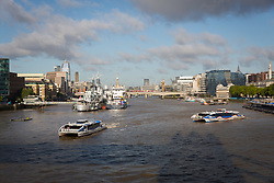 © Licensed to London News Pictures. 12/09/2017. LONDON, UK.  Two Clipper commuter boats pass in front of THV Galatea, which has arrived in London and is moored next to HMS Belfast for London International Shipping Week. THV Galatea is a Trinity House multi-function ship, designed to carry out marine operations as part of their duty as the General Lighthouse Authority for England, Wales, the Channel Islands and Gibraltar. An estimated 15,000 shipping industry leaders are expected to attend events in London and on board the THV Galatea during International Shipping Week this week. Photo credit: Vickie Flores/LNP