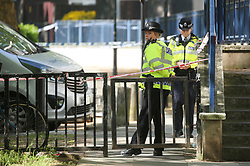 © Licensed to London News Pictures. 06/05/2018. London, UK. Police at the scene where a 17-year-old boy has died after being shot on Cooks Road in Kennington, Southwark south London. Photo credit: Isabel Infantes/LNP