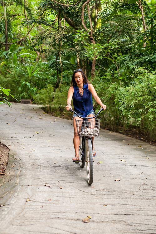 A guest enjoys a bike ride at Latitude 10 Resort, Santa Teresa, Costa Rica.