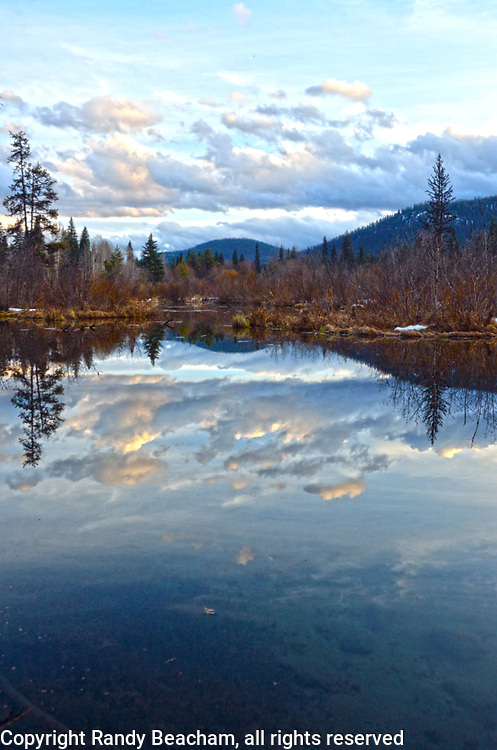 Upper Ford Wetlands at sunset in spring. Yaak Valley in the Purcell Mountains, northwest Montana.