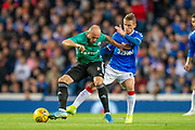 Valerian Gvilia (#8) of Legia Warsaw is tackled by Steven Davis (#10) of Rangers FC during the Europa League Play Off leg 2 of 2 match between Rangers FC and Legia Warsaw at Ibrox Stadium, Glasgow, Scotland on 29 August 2019.