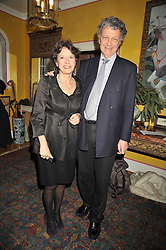 WILLIAM & OLGA SHAWCROSS at a party to celebrate the publication of Charles Glass's new book 'Americans in Paris' held at 12 Lansdowne Road, London W1 on 25th March 2009.