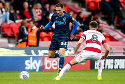 Alex Rodman of Bristol Rovers takes on Ben Whiteman of Doncaster Rovers - Mandatory by-line: Robbie Stephenson/JMP - 19/10/2019 - FOOTBALL - The Keepmoat Stadium - Doncaster, England - Doncaster Rovers v Bristol Rovers - Sky Bet League One