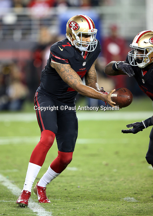 San Francisco 49ers quarterback Colin Kaepernick (7) hands off the ball on a running play to San Francisco 49ers running back Carlos Hyde (28) during the 2015 NFL week 1 regular season football game against the Minnesota Vikings on Monday, Sept. 14, 2015 in Santa Clara, Calif. The 49ers won the game 20-3. (©Paul Anthony Spinelli)