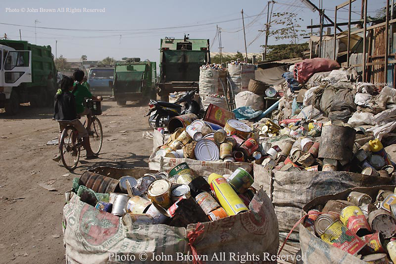 Large sacks filled wth recyclable cans, bottles, and plastic sit outside a recycling facility near the Stung Meanchey Landfill in Phnom Penh, Cambodia. Over 2000 people work at the dump daily, sifting through 700 tons of garbage that arrives each day.