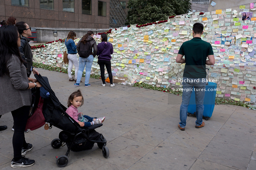 A shrine of flowers and compassionate messages continue to grow ten days after the terrorist attack on London Bridge and Borough Market, on 12th June 2017 in London, England. Near the southern-most boundary of the City of London opposite to the attack location, Londoners and visitors to the capital leave their emotional and defiant poems and personal messages on post-it notes.