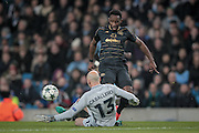 Moussa Dembélé (Celtic) watches as his shot is saved by Willy Caballero (Manchester City) during the Champions League match between Manchester City and Celtic at the Etihad Stadium, Manchester, England on 6 December 2016. Photo by Mark P Doherty.