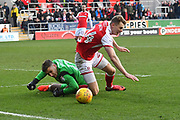 Doncaster Rovers goalkeeper Marko Marosi (13) brings down Rotherham United player Michael Smith (24) in the penalty area during the EFL Sky Bet League 1 match between Rotherham United and Doncaster Rovers at the AESSEAL New York Stadium, Rotherham, England on 24 February 2018. Picture by Ian Lyall.