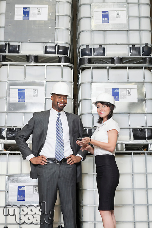 Portrait of multiethnic business colleagues standing in manufacturing industry