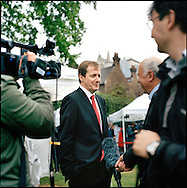 UK. London. From a story on Abingdon Street Gardens, a small patch of land, often referred to as College Green, that lies next to The Houses of Parliament in Westminster. It is a place where the media and the politicians come face to face. Interviews are held, photo shoots are set up and bewildered tourists stroll by..Photo shows Alastair Campbell, Tony Blair?s former Press Secretary being interviewed on day the day of The British prime Minister's resignation..Photo©Steve Forrest/Workers Photos ..