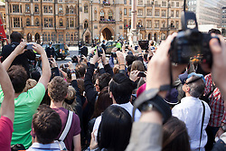 © Licensed to London News Pictures. 04/06/2013. London, UK. Royal fans with camera phones and media are seen outside Westminster Abbey in London today (04/06/2013) taking pictures of members of the Royal Family as they wait the arrival of Her Majesty the Queen as she attends a service celebrating the anniversary of her coronation. Photo credit: Matt Cetti-Roberts/LNP
