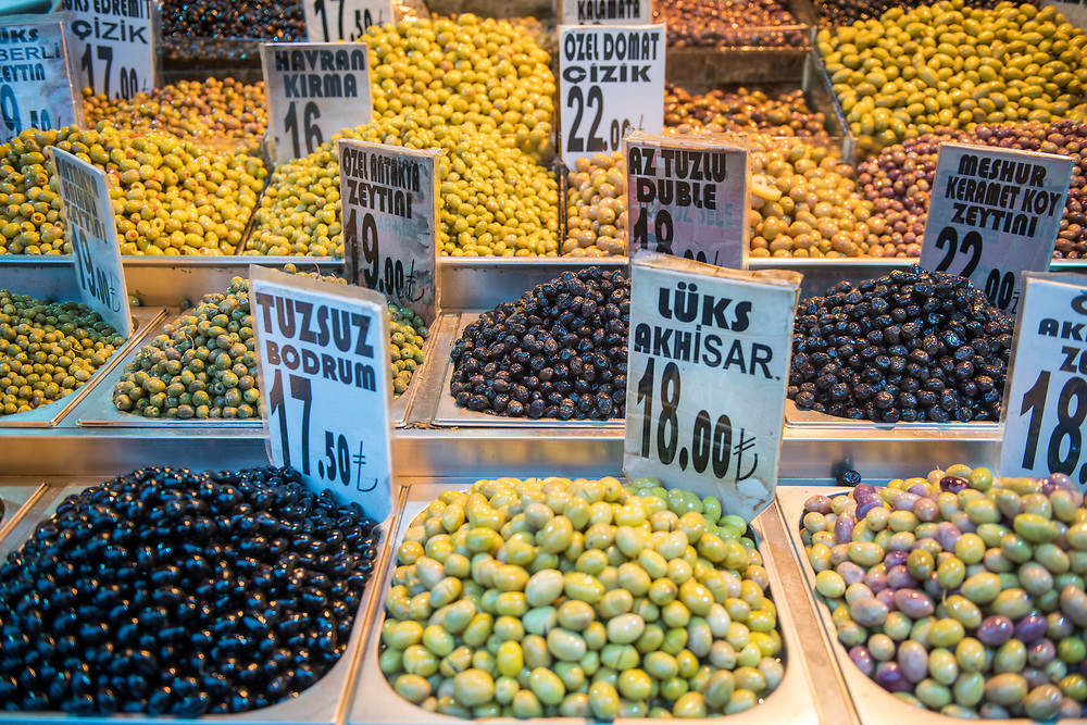 Bins are filled to the brim with a variety of different olives at Istanbul Spice bazaar in Turkey