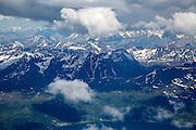 Broken cumulus cloud seen from above looking down over mountain peaks, western Norway near Tromso
