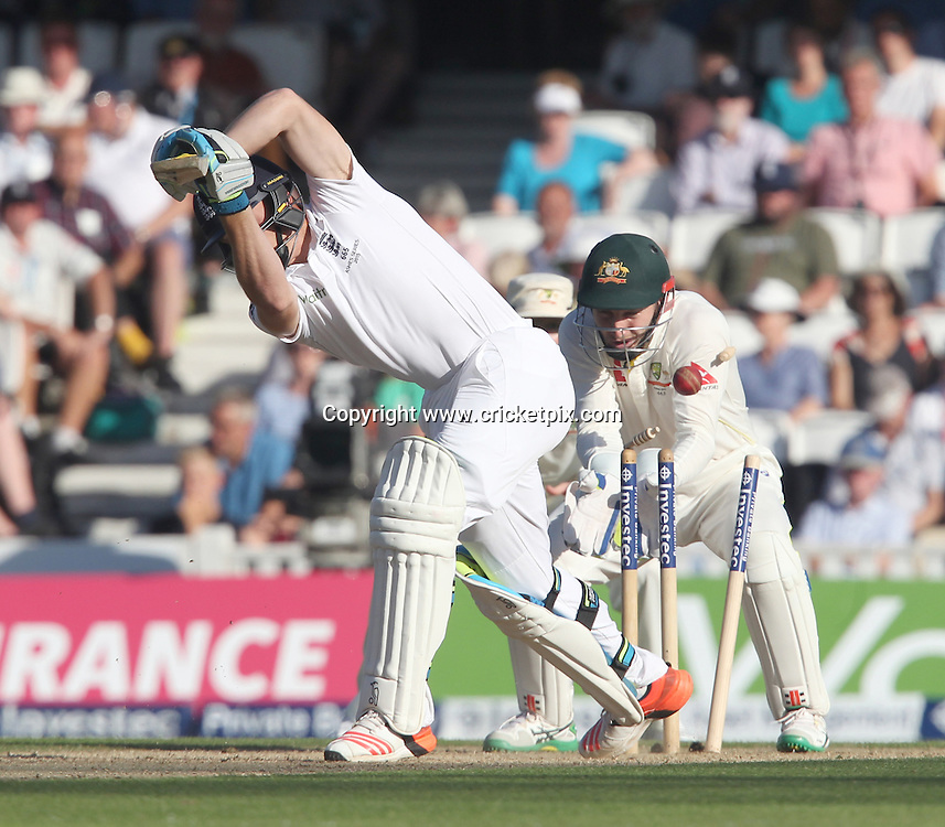 Jos Butler of England is bowled out by Nathan Lyon of Australia. England v Australia, 5th and final Ashes Test, Day 2, Oval, London. 21/08/2015 © Matthew Impey/www.cricketpix.com