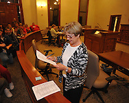Lafayette County circuit clerk Mary Alice Busby reads vote totals at the Lafayette County Courthouse in Oxford, Miss. on Tuesday, November 8, 2011.