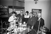 2/7/1964<br /> 7/2/1964<br /> 2 July 1964<br /> <br /> An Taoiseach Mr. Sean Lemass watching a laboratory test on Guinness by Frank Edge the Laboratory Assistant also in the picture are Lord Boyd. Director, Lord Elveden Managing Director, Lady Elveden, Lord Mayne Director and Dr. A.K Mills the Chief Chemist