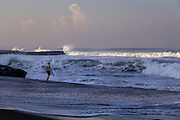 A surfer at Echo beach, Canggu.