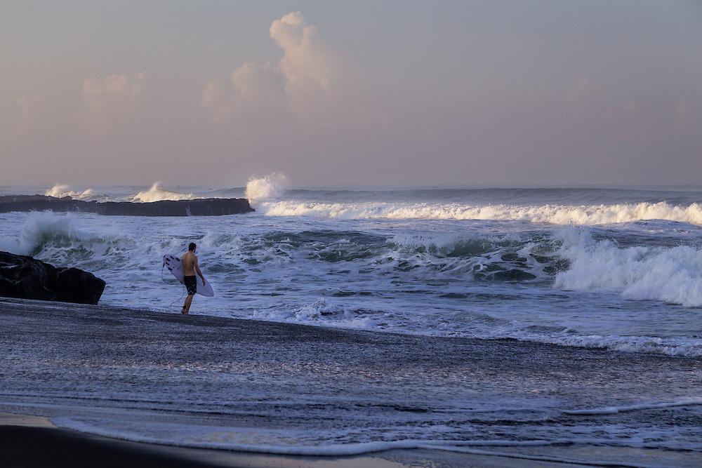 A surfer at Echo beach, Canggu.