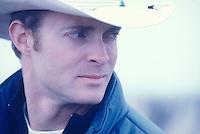 Portrait of a man wearing a cowboy hat.