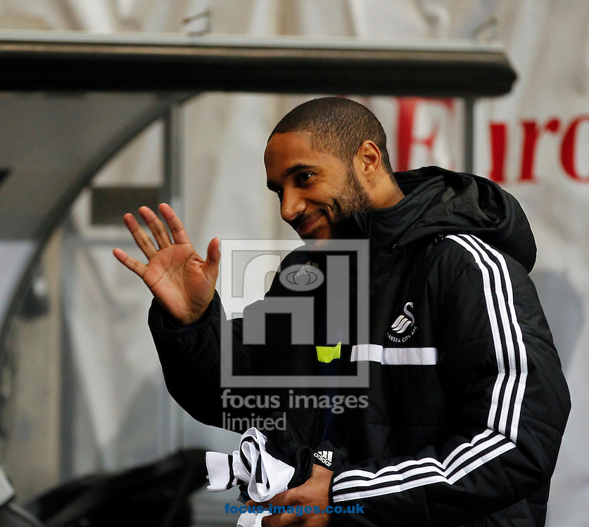 Picture by Mike  Griffiths/Focus Images Ltd +44 7766 223933<br /> 28/11/2013<br /> Ashley Williams of Swansea City takes his position on hte bench against Valencia Club de F&uacute;tbol during the UEFA Europa League match at the Liberty Stadium, Swansea.